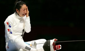 Women's Epeeist, Shin Lam of Korea, after her controversial defeat in the 2012 Olympics. Photo from TheGaurdian.com